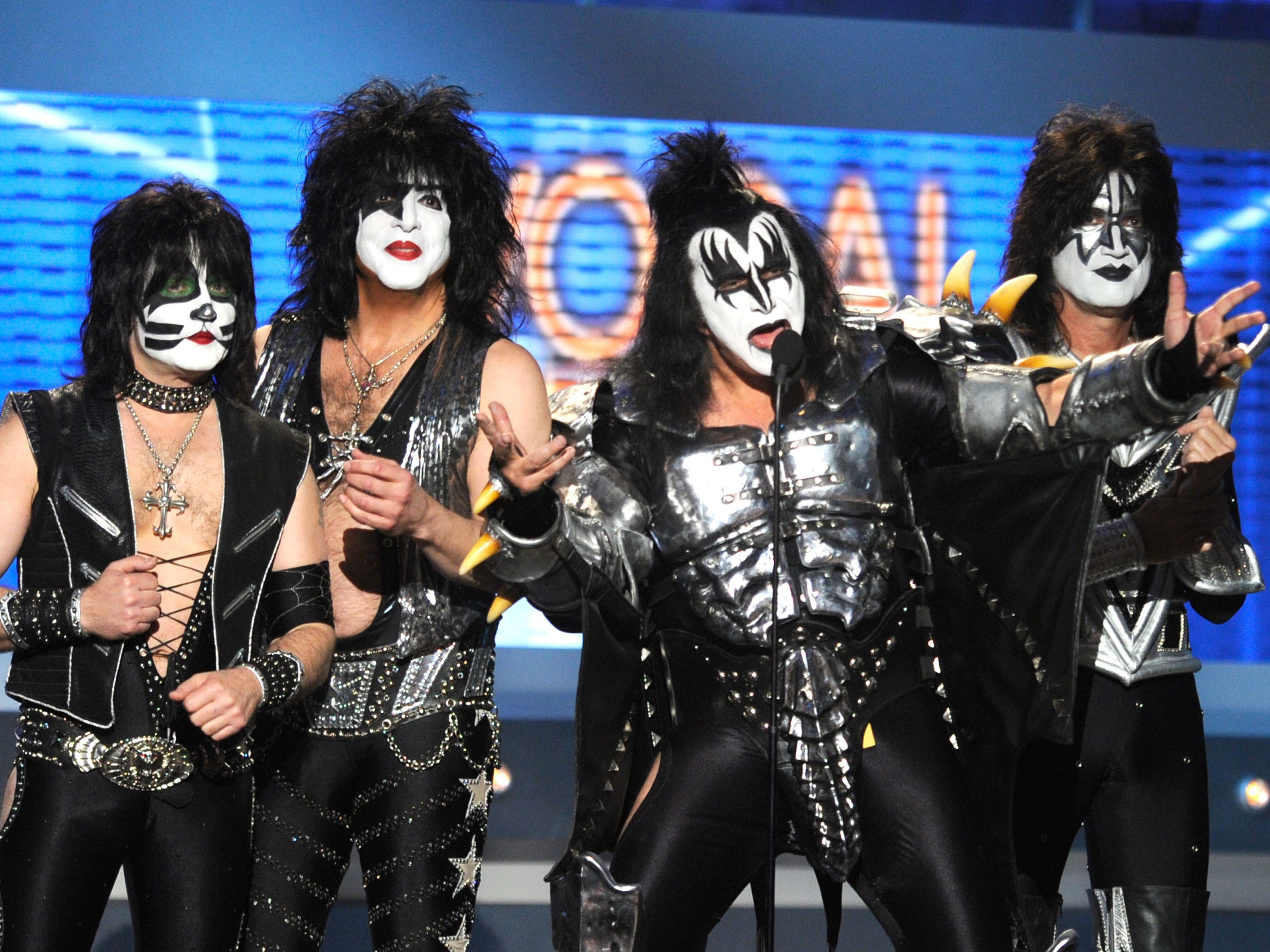 LAS VEGAS, NV - APRIL 01:  Musicians Eric Singer, Paul Stanley, Gene Simmons and Tommy Thayer of KISS speak onstage at the 47th Annual Academy Of Country Music Awards held at the MGM Grand Garden Arena on April 1, 2012 in Las Vegas, Nevada.  (Photo by Ethan Miller/Getty Images)