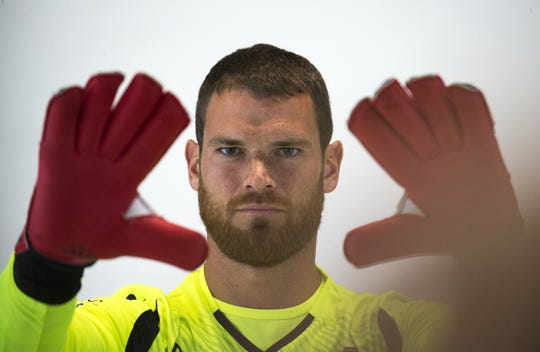 Goalkeeper Carl Woszczynski poses for a photo during the Phoenix Rising's media day on Feb. 13.