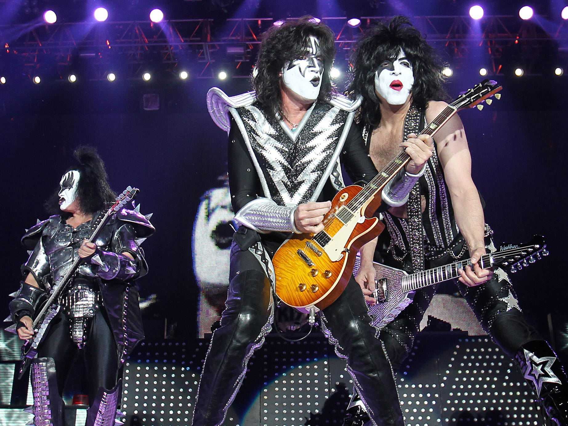 """(L-R) Gene Simmons, Tommy Thayer and Paul Stanley of the US hard-rock band Kiss perform on stage on May 25, 2010 in Leipzig, eastern Germany. It was the first concert of the band's German tour titled """"Sonic Boom Over Europe"""".     AFP PHOTO    DDP/SEBASTIAN WILLNOW    GERMANY OUT (Photo credit should read SEBASTIAN WILLNOW/AFP/Getty Images)"""