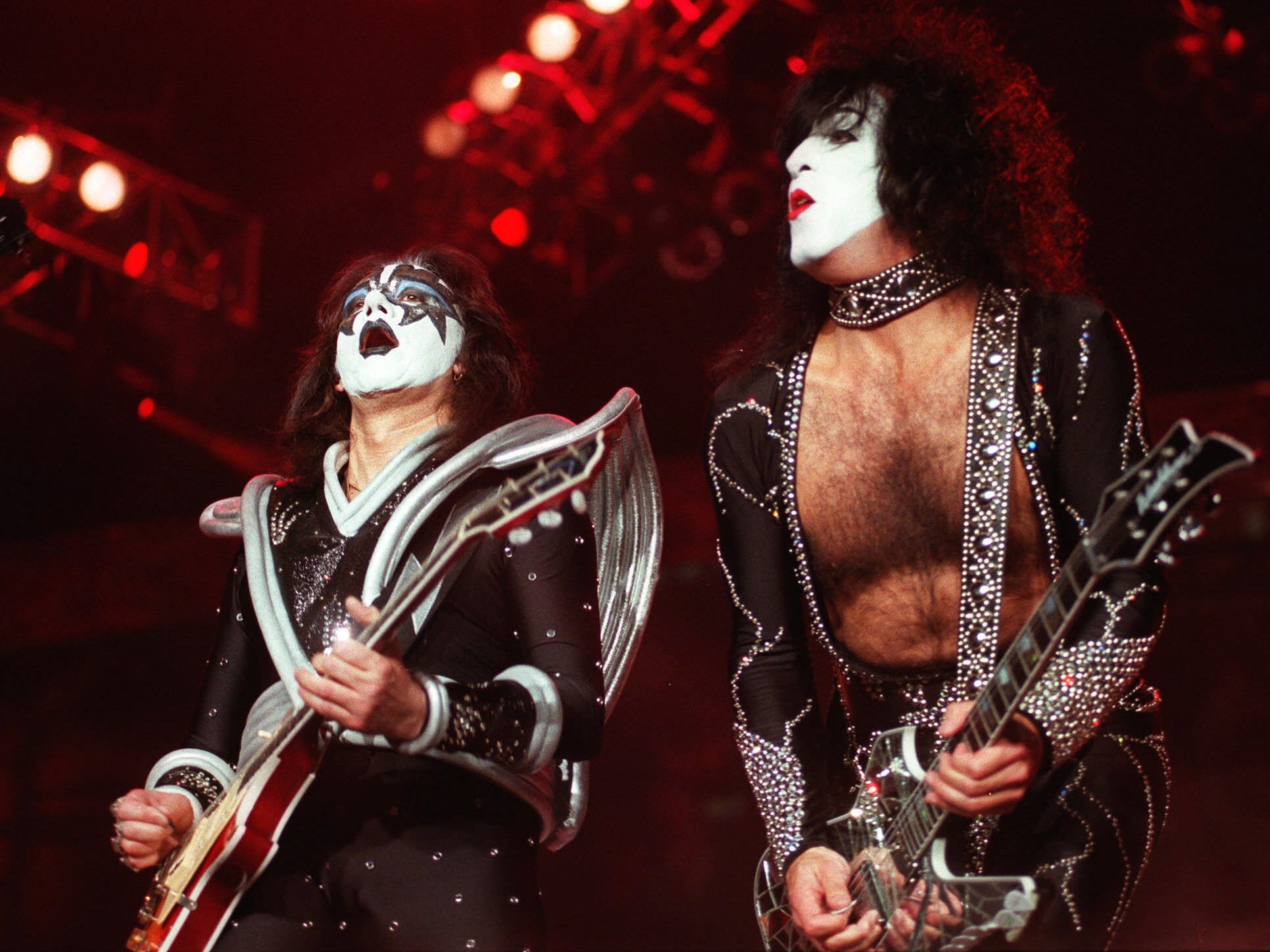 """Paul Stanley (right) and Ace Frehley of the rock band Kiss perform during their sold-out Halloween concert at Dodger Stadium in Los Angeles on Saturday, Oct. 31, 1998. The concert marked the debut of their """"Psycho Circus"""" tour."""