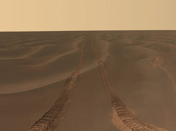 This panoramic image was taken by the Mars Exploration Rover Opportunity on July 28, 2005. The rover was stuck in the dune's deep, fine sand for more than a month.