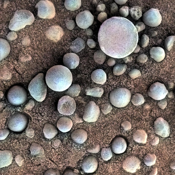 """NASA's Mars Opportunity Rover took this close up image ofmineral concretions nicknamed """"blueberries."""" Opportunity's investigation of the hematite-rich concretions provided evidence of a watery ancient environment. This image was taken April 19, 2004."""