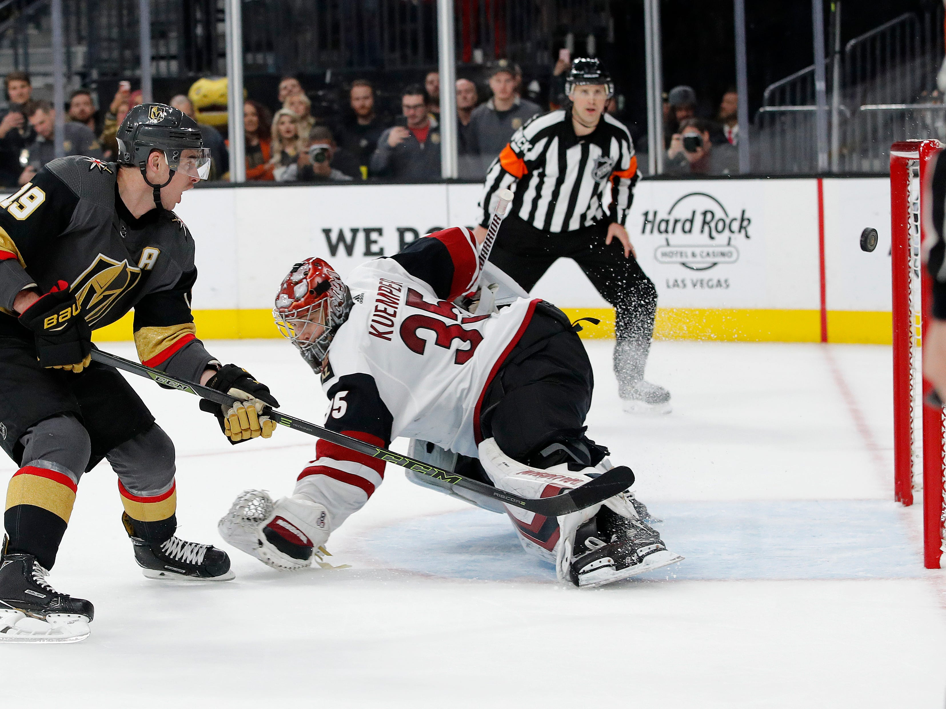Vegas Golden Knights right wing Reilly Smith (19) misses a penalty shot against Arizona Coyotes goaltender Darcy Kuemper (35) during the second period of an NHL hockey game Tuesday, Feb. 12, 2019, in Las Vegas. (AP Photo/John Locher)