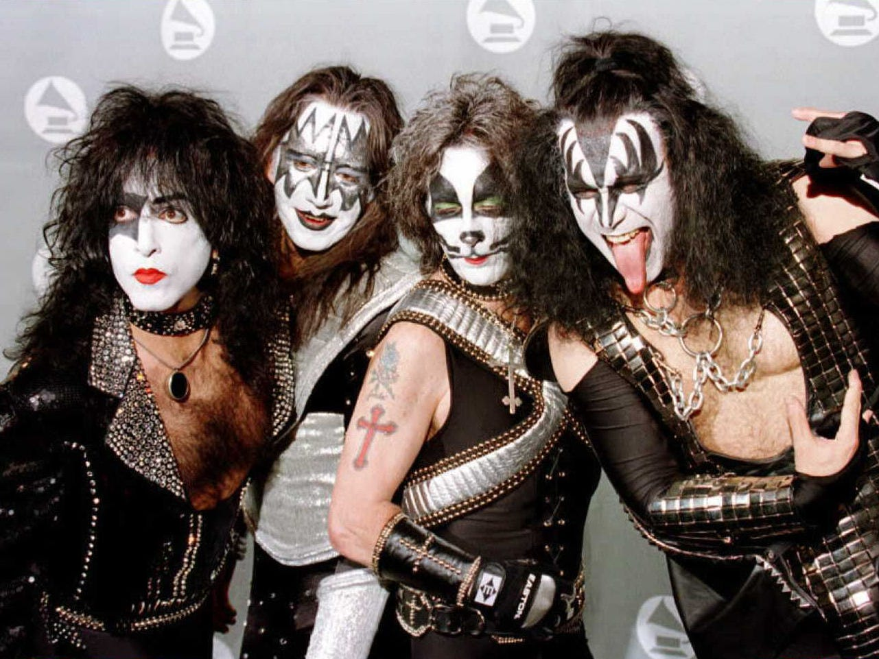 """LOS ANGELES, UNITED STATES:  Members of the veteran rock group """"KISS"""" pose for photographers in the photo room at the 38th Annual Grammy Awards in Los Angeles 28 February. The group were presenters at the awards ceremony."""
