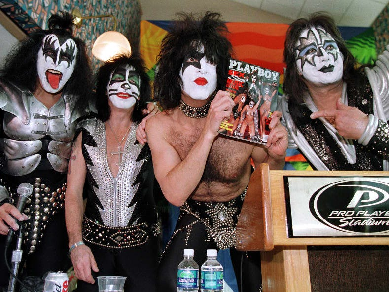 MIAMI: Paul Stanley, lead singer for the rock group KISS, holds up a Playboy Magazine -- in which the band has a spread -- with the other members of the band on Jan. 29 during a press conference at Pro Player Stadium. The band performed there before the Super Bowl XXXIII pre-show. (From left to right: Gene Simmons, Peter Criss, Stanley and Ace Frehley.)