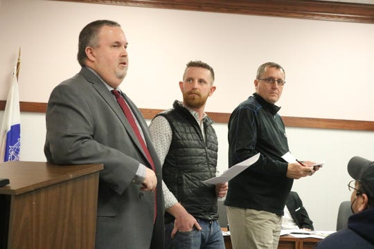 Mike Snider, Mike Roder and Mike Zipfel, of the MORA Committee, present their proposal for a designated outdoor refreshment area in Port Clinton to city council members on Tuesday.