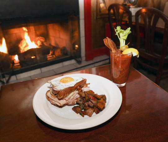 The Challah French toast Monte Christo with the Handmade Bloody Mary with bacon on the menu at Cold Spring Depot in Cold Spring on Wednesday, February 13, 2019.