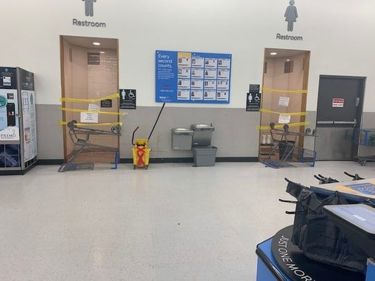 The bathrooms located in the front of the Walmart store in Fishkill are barricaded by shopping carts and yellow tape as seen on Saturday, Feb. 9, 2019.