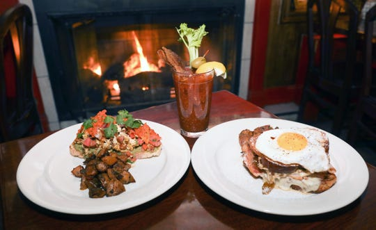 The Chorizo scramble, left, and the Challah French toast Monte Christo with the Handmade Bloody Mary with bacon on the menu at Cold Spring Depot in Cold Spring.