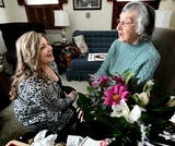 Visiting Angels care managers surprise clients with flowers for the holiday during its Blossoms of Love campaign.