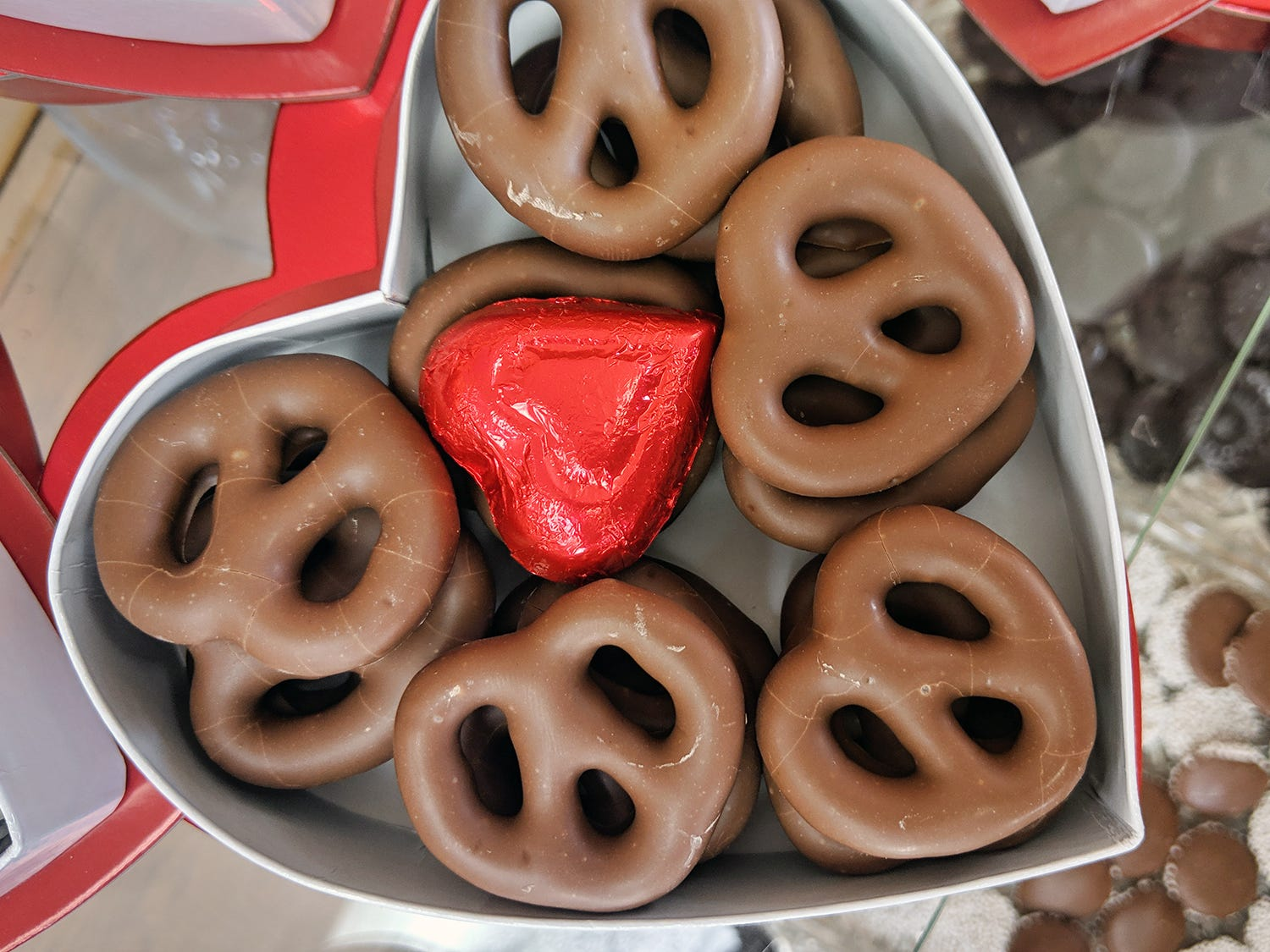 Sturgis pretzels dipped in chocolate are packed in Valentine's Day boxes at Fitzkee's Candies Inc., 2352 S. Queen St. in York Township.