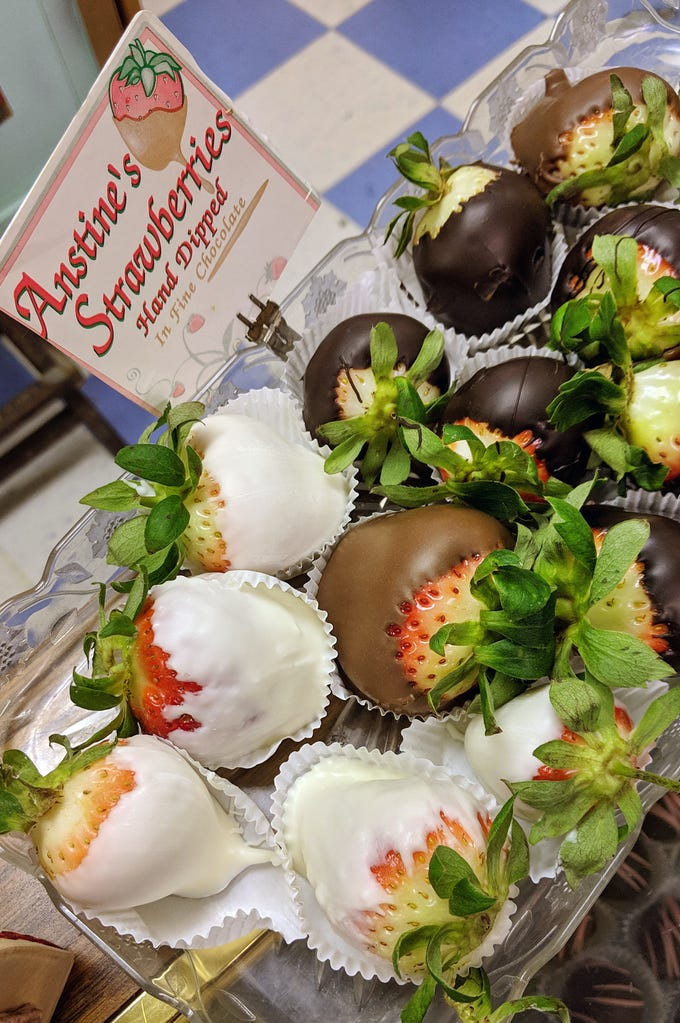 Two local candy makers, in business for years, revved up for the Valentine's Day rush. Here, hand-dipped strawberries are shown at Anstine's Candy, at 1901 S. Queen St. in Spring Garden Township..