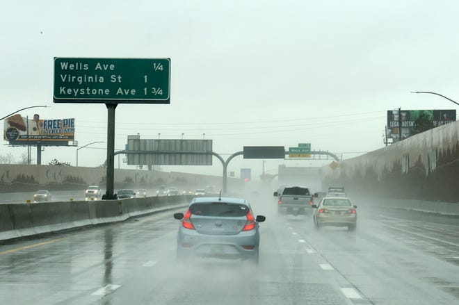West bound I-80 traffic moves on a rainy Wednesday morning in Reno on Feb. 13, 2019.