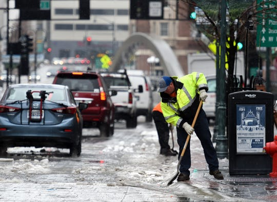 City workers clear the frozen snow on Virginia Street in downtown Reno on Feb. 13, 2019.