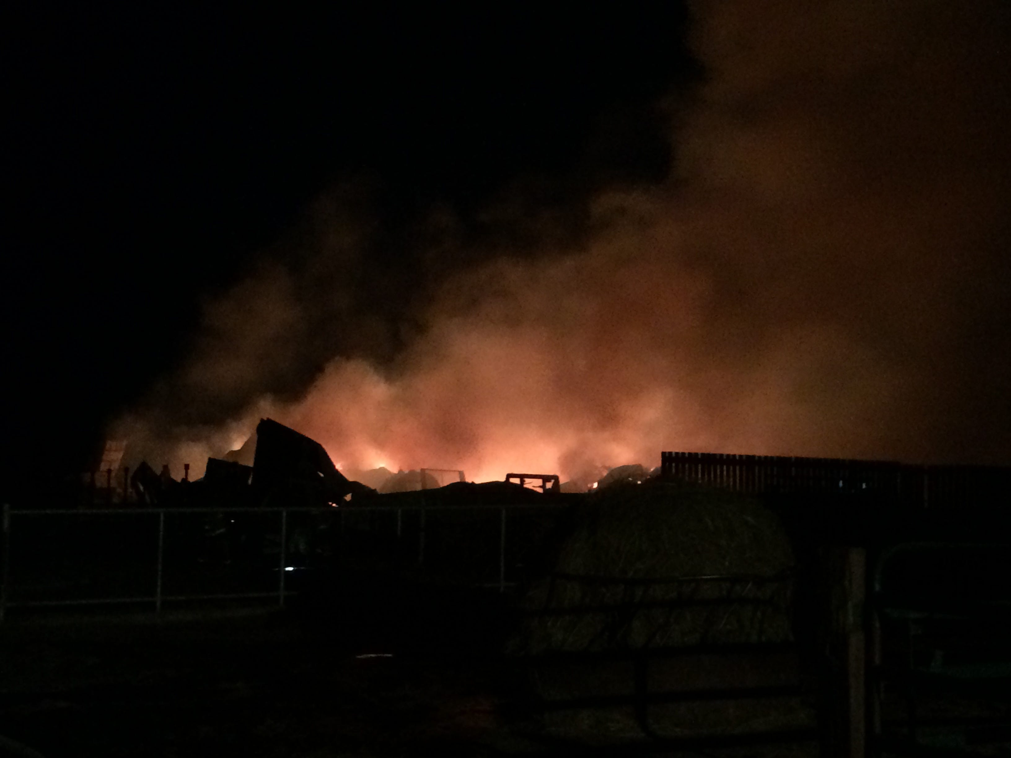 The remnants of a cattle barn burn before dawn Wednesday at the Gerber farm across Ind. 227 from Richmond Municipal Airport.