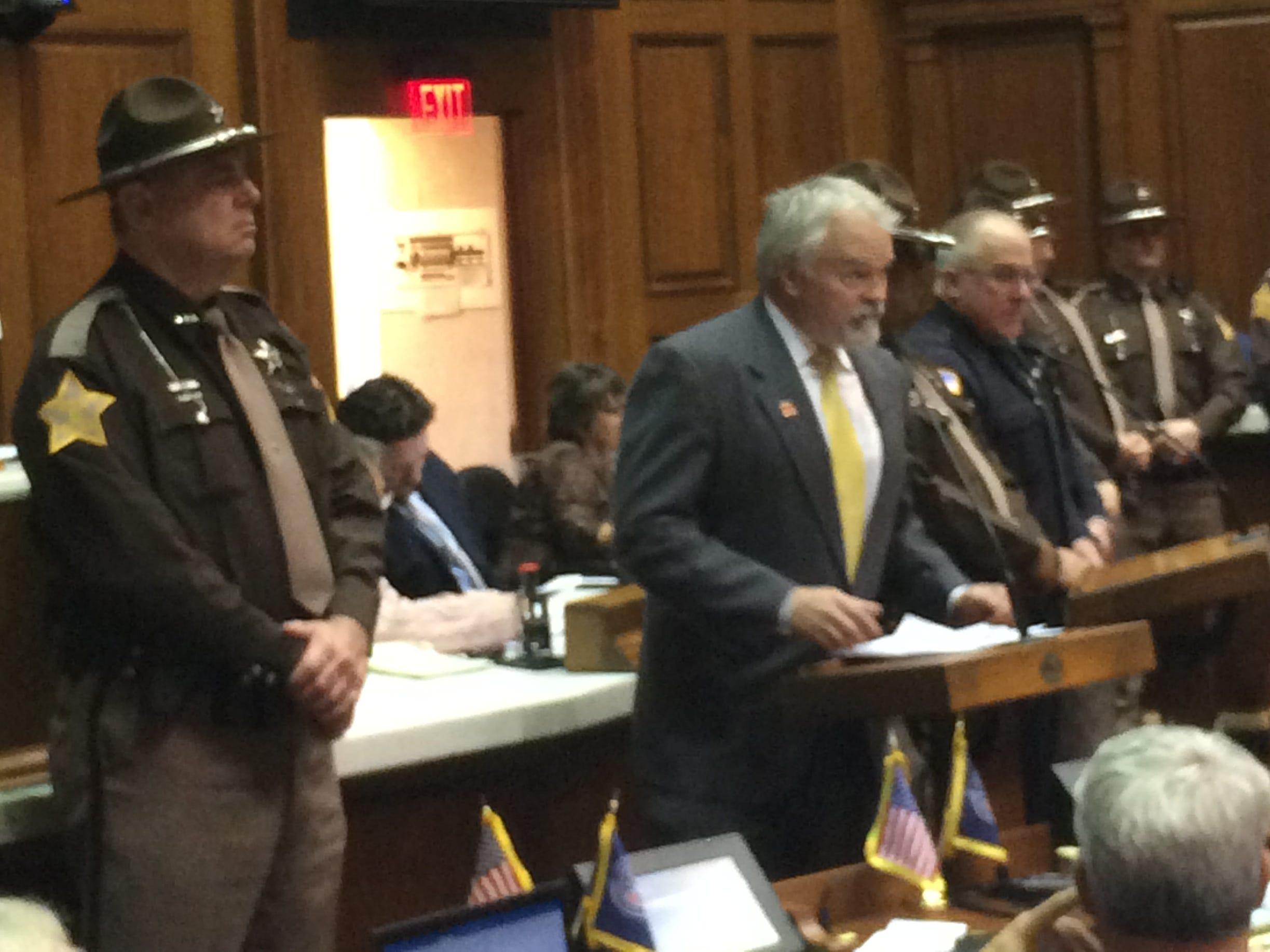 Rep. Brad Barrett speaks in the House chambers Tuesday.