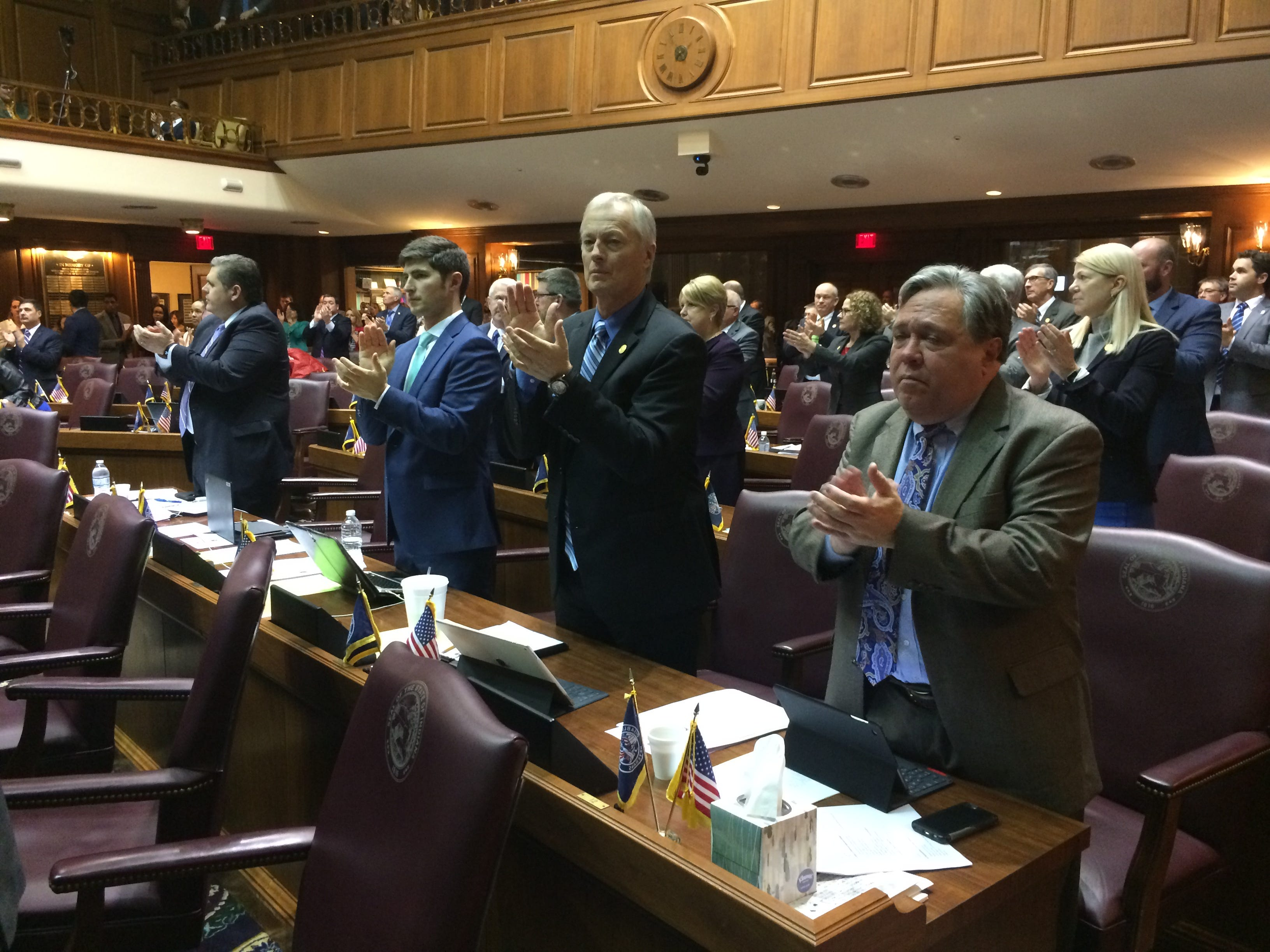 House members applaud after being presented with a resolution honoring school and law enforcement personnel for their actions Dec. 13 at Dennis Intermediate School.