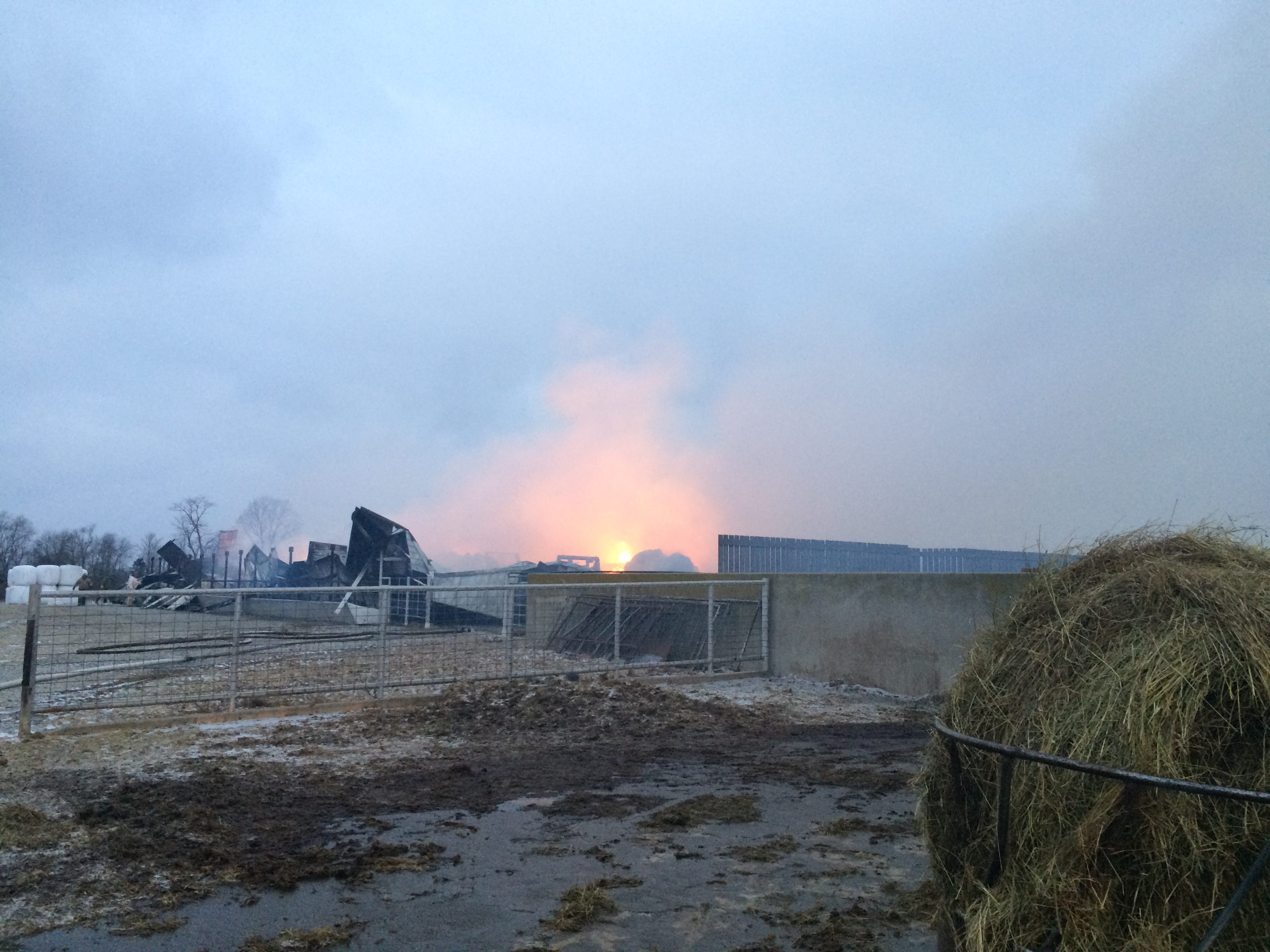 As dawn broke Wednesday remnants of a cattle barn continued burning at the Gerber farm across Ind. 227 from Richmond Municipal Airport.