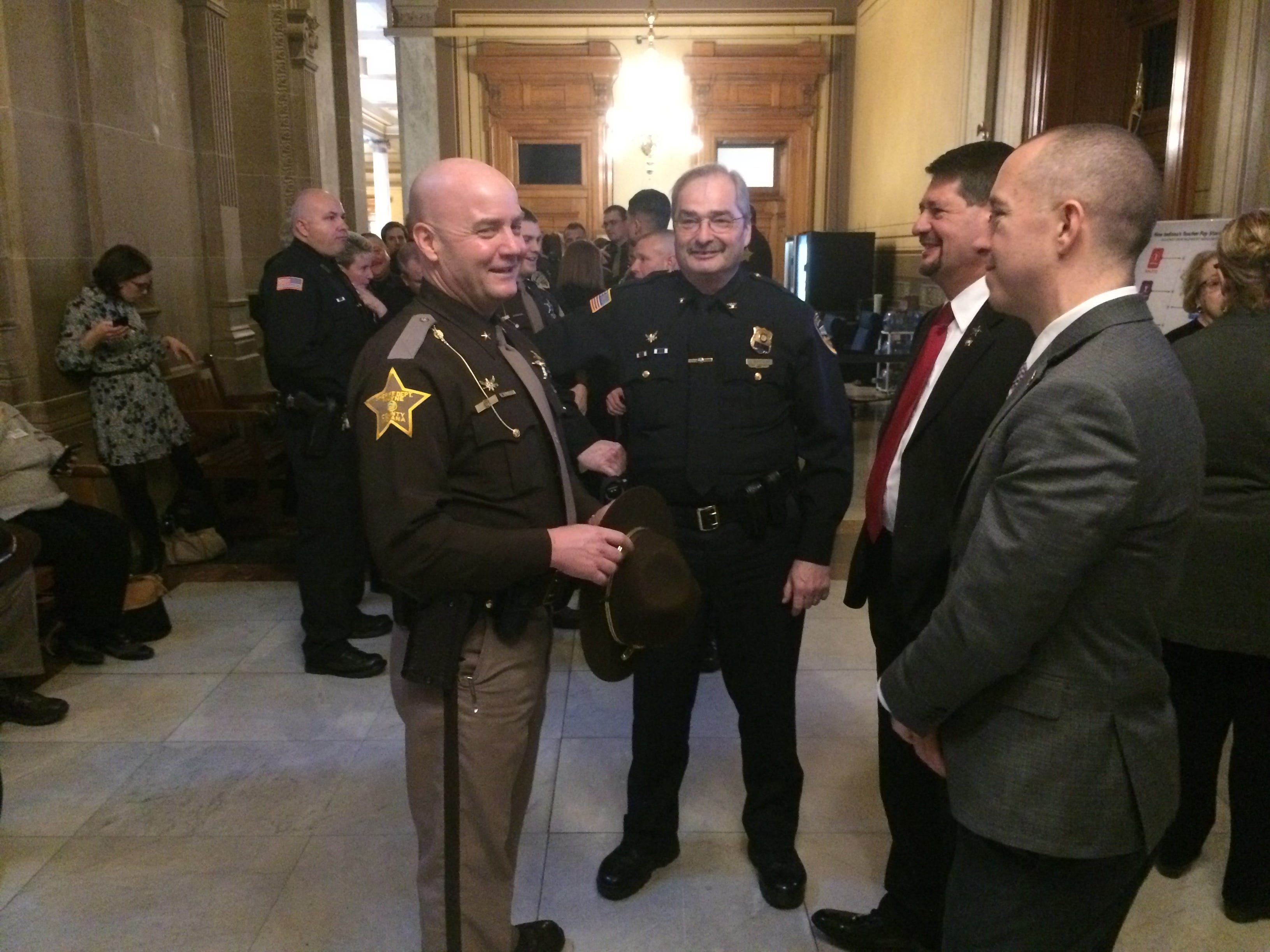 Sheriff Randy Retter, Chief Jim Branum, former Sheriff Jeff Cappa and Mayor Dave Snow wait outside the Senate chambers Tuesday.