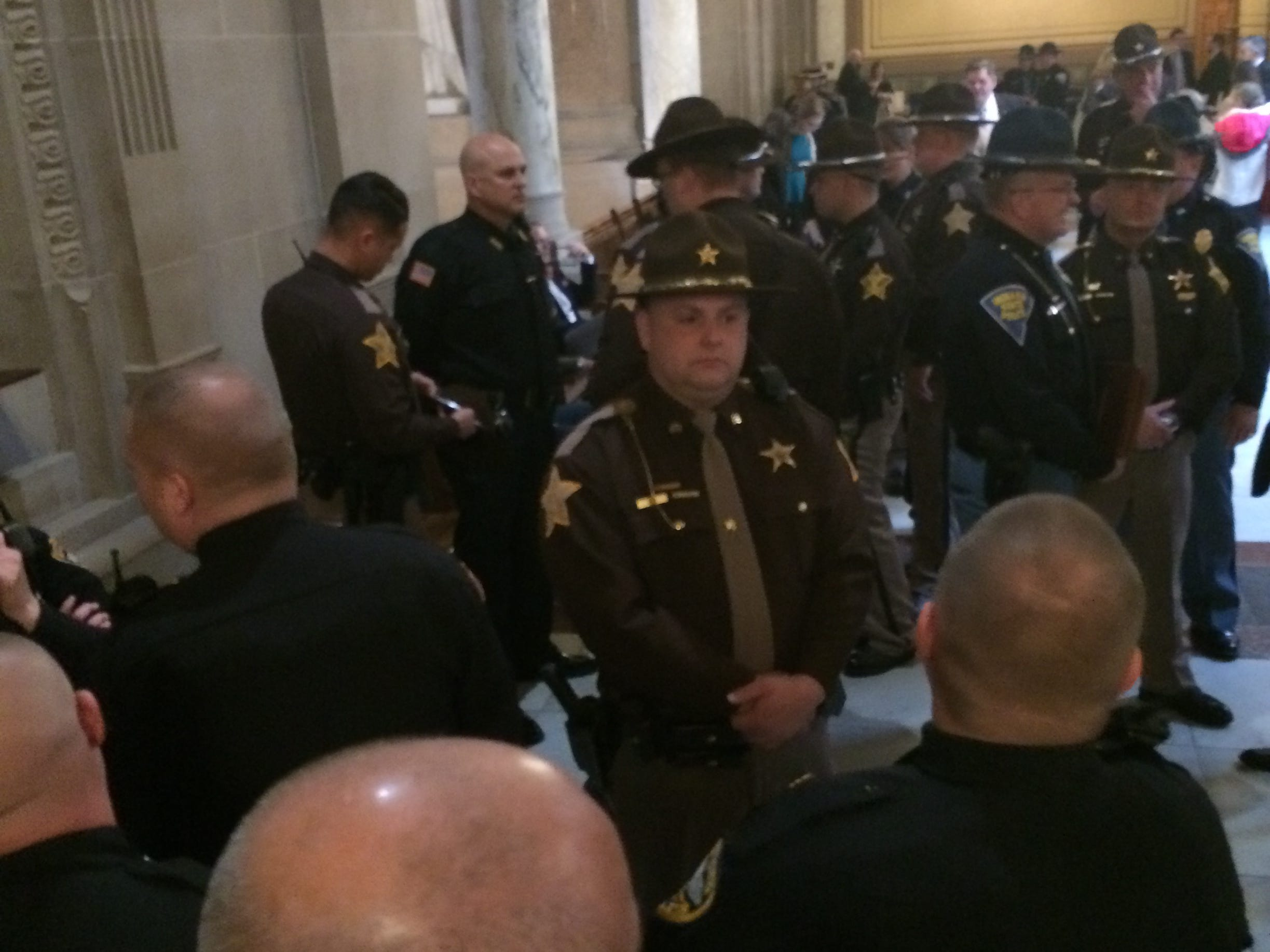 Richmond and Wayne County law enforcement officers wait outside the House chambers Tuesday.