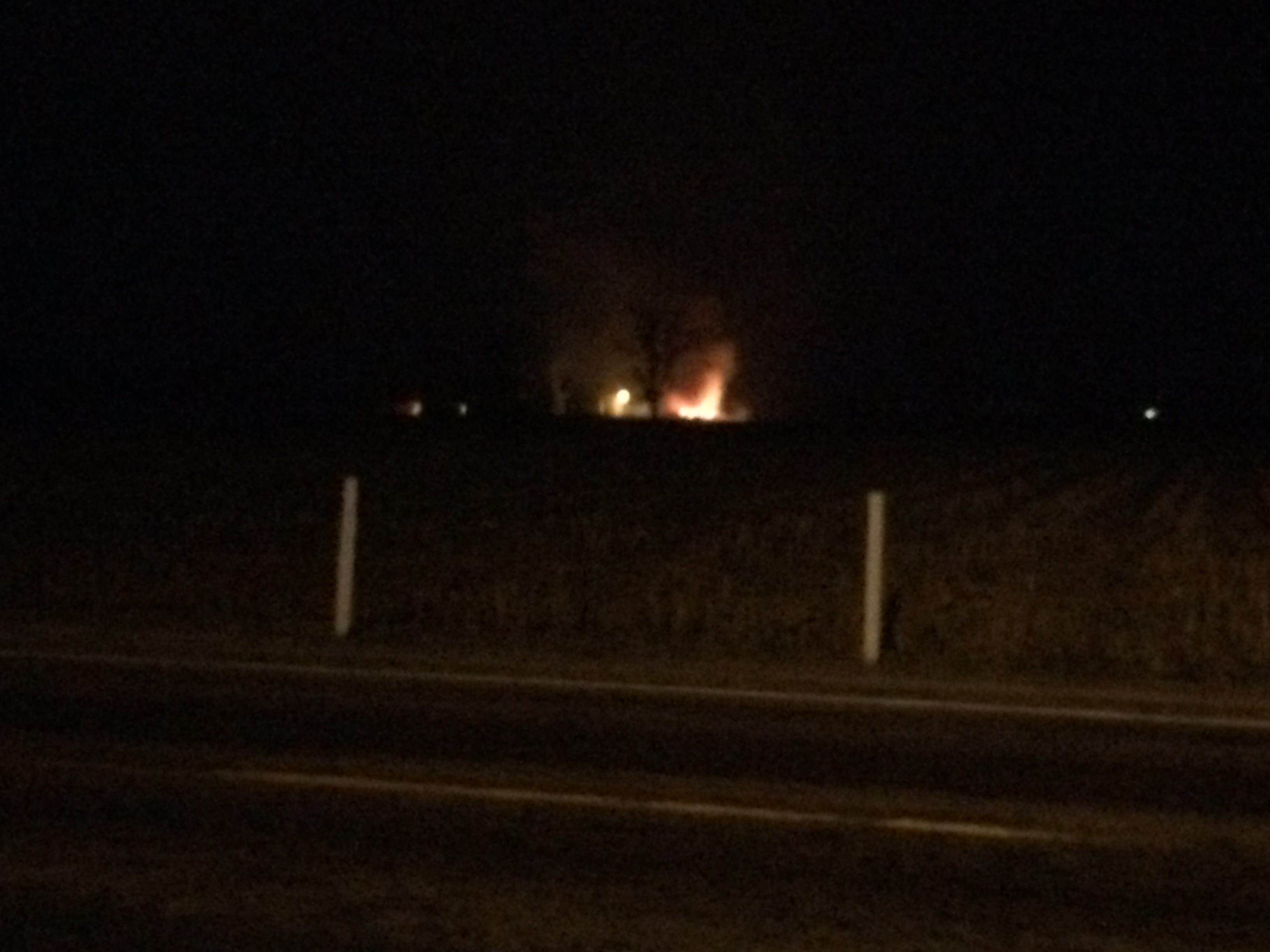 Flames from a burning barn were visible from Ind. 227 at Richmond Municipal Airport on Wednesday morning.