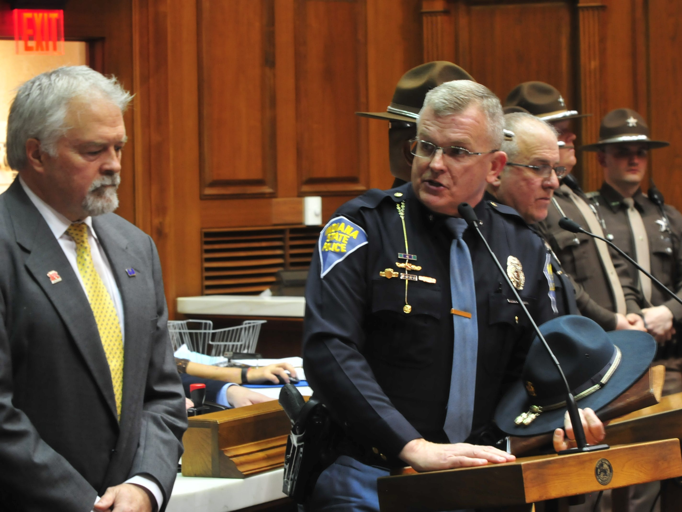 Indiana State Police Superintendent Doug Carter speaks during a ceremony inside the Indiana House chambers.
