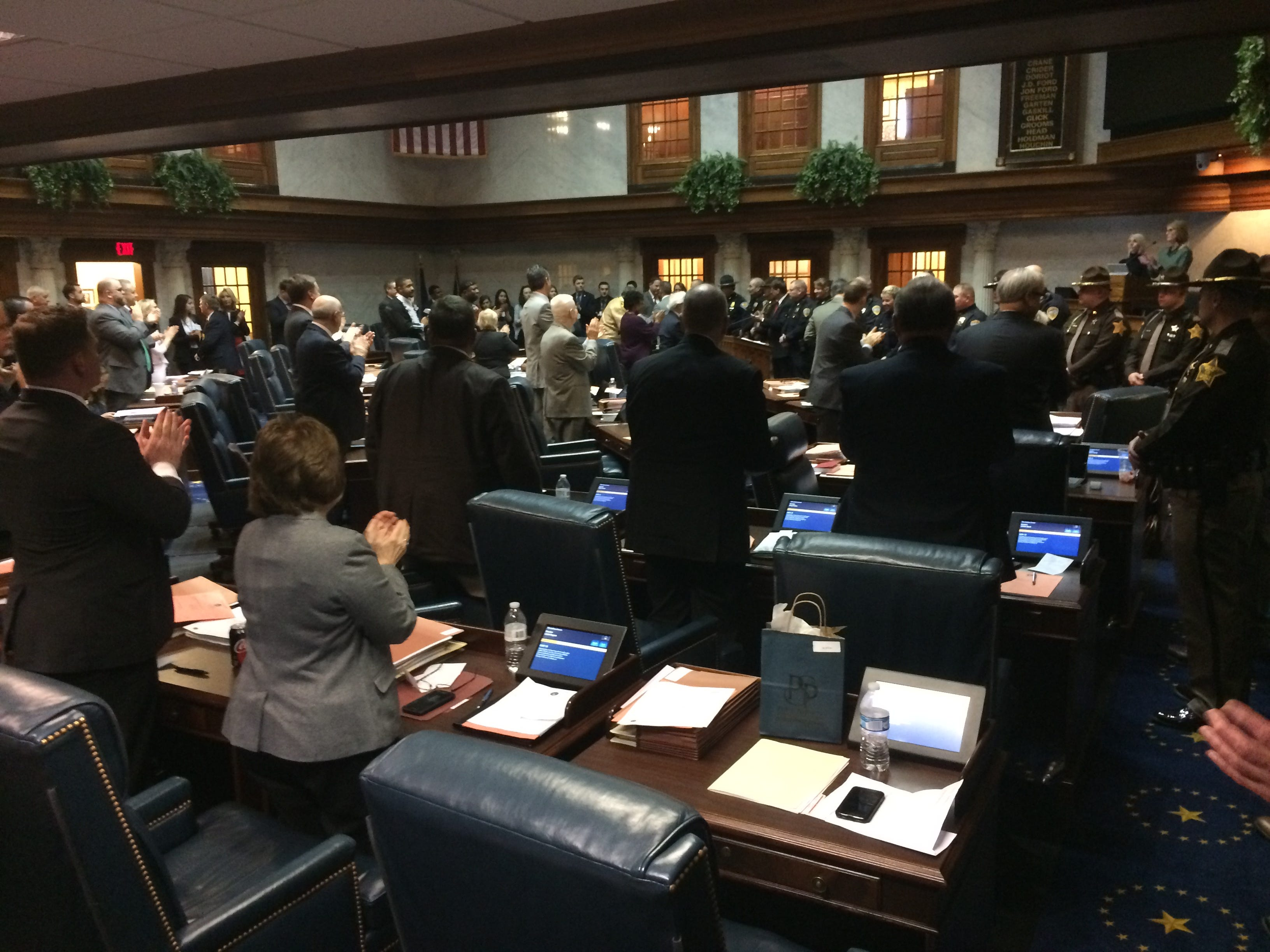 Senate members applaud after passing a resolution to honor school and law enforcement personnel for their actions Dec. 13 at Dennis Intermediate School.