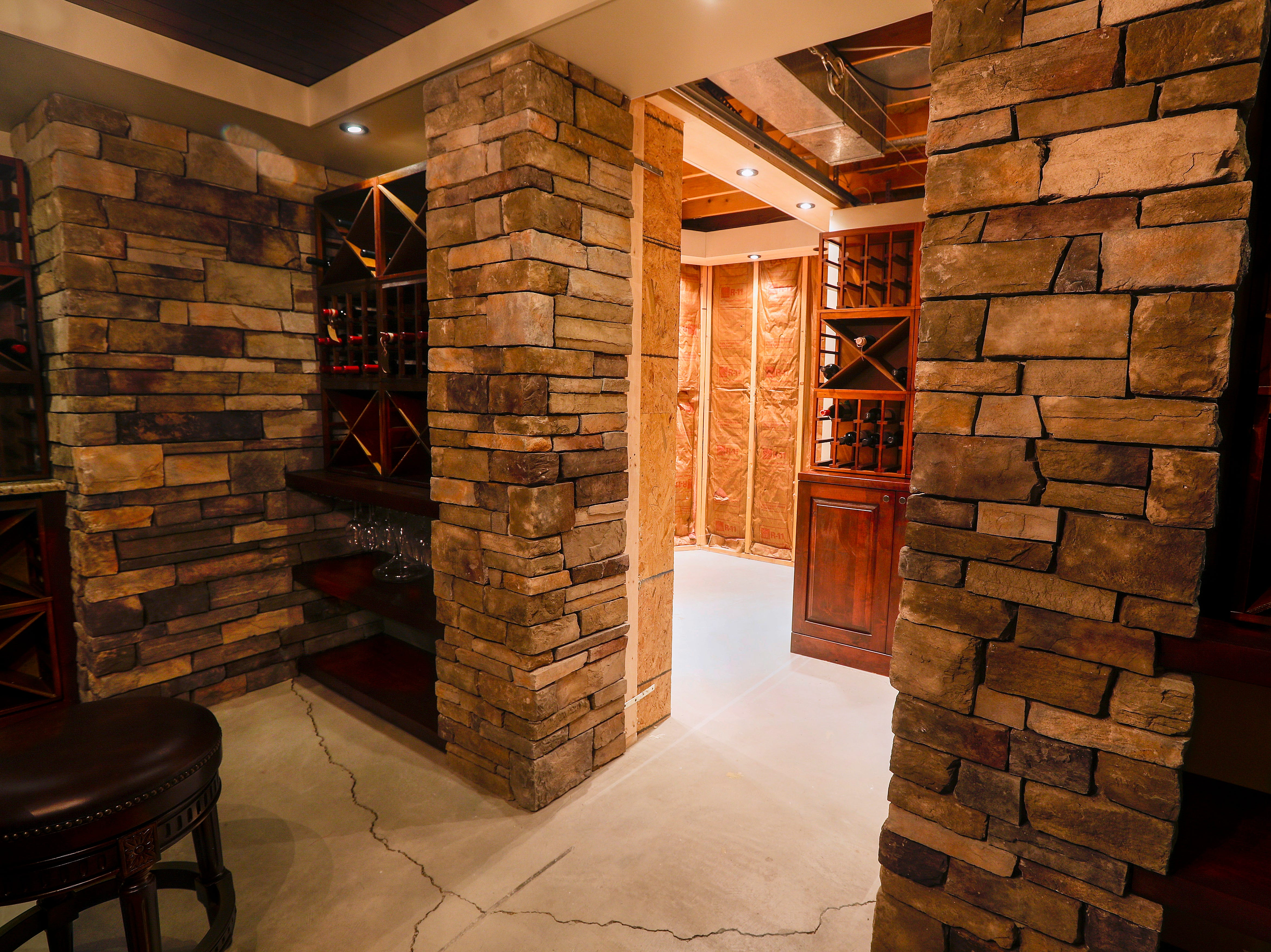 The wine cellar includes a retractable panel that exposes a hidden room.