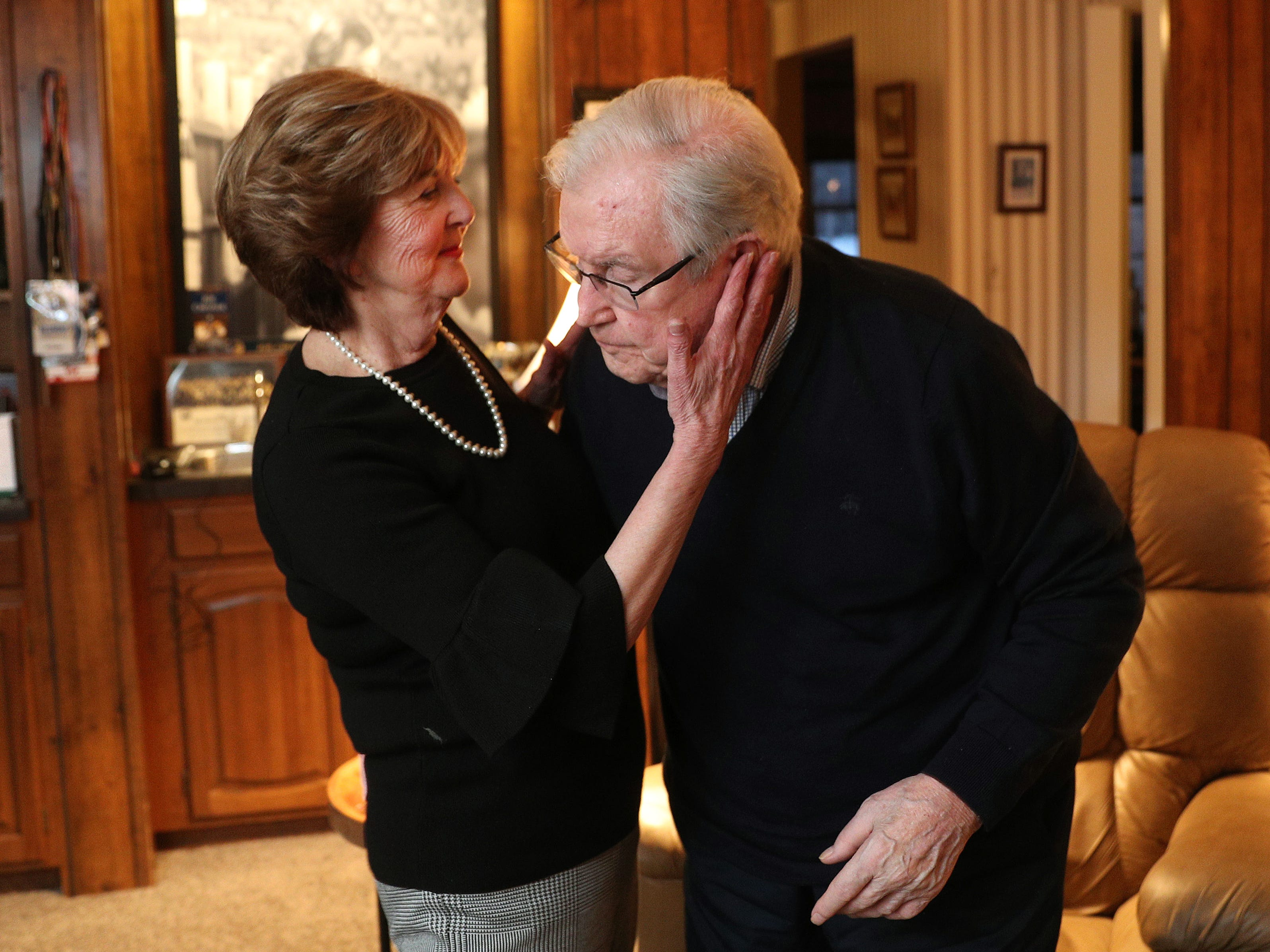 Bonnie Crozier comforts her husband, Joe, in their Amherst home.  The couple married in 1974. Joe Crozier turns 90 on Feb. 19, 2019, and is suffering from accelerating dementia.