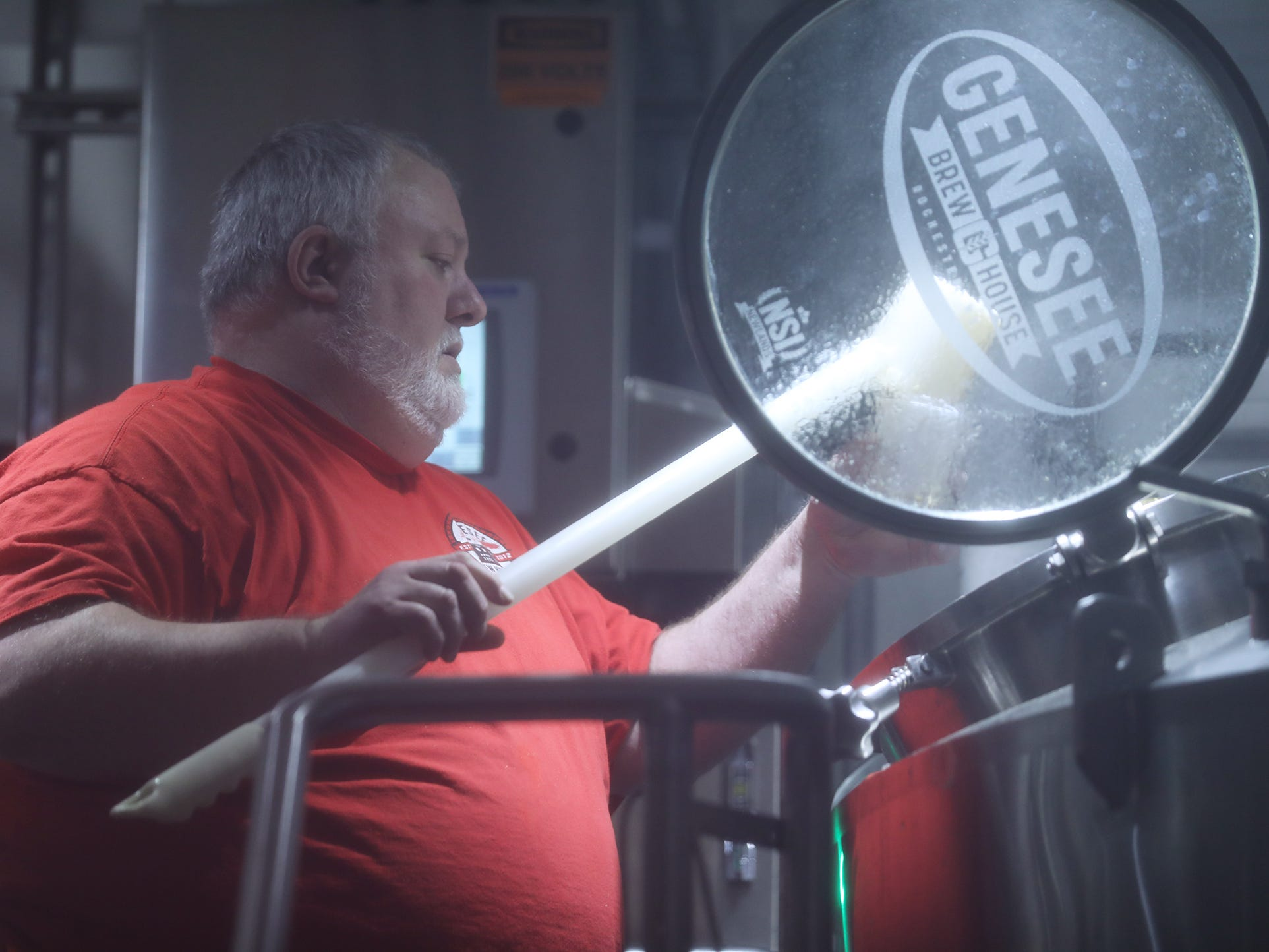 Dean Jones, brewmaster at the Genesee Brew House, takes a sample of the mash during a collaborative brew day with Other Half Brewing on Feb. 12. The two breweries are teaming to release Genesee Dream Ale.