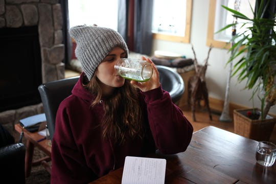 Emma Madden drinks a kale juice at the Just Juice 4 Life retreat