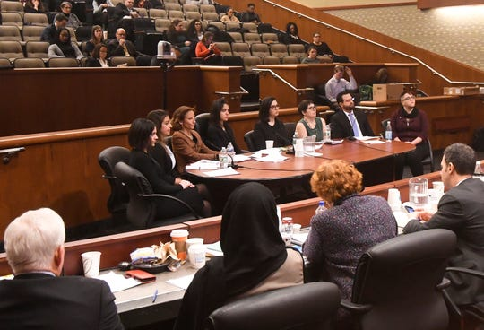 Survivors from the Sexual Harassment Working Group Members speak to New York state legislators during a public hearing on sexual harassment in the workplace Wednesday, Feb. 13, 2019, in Albany, N.Y.