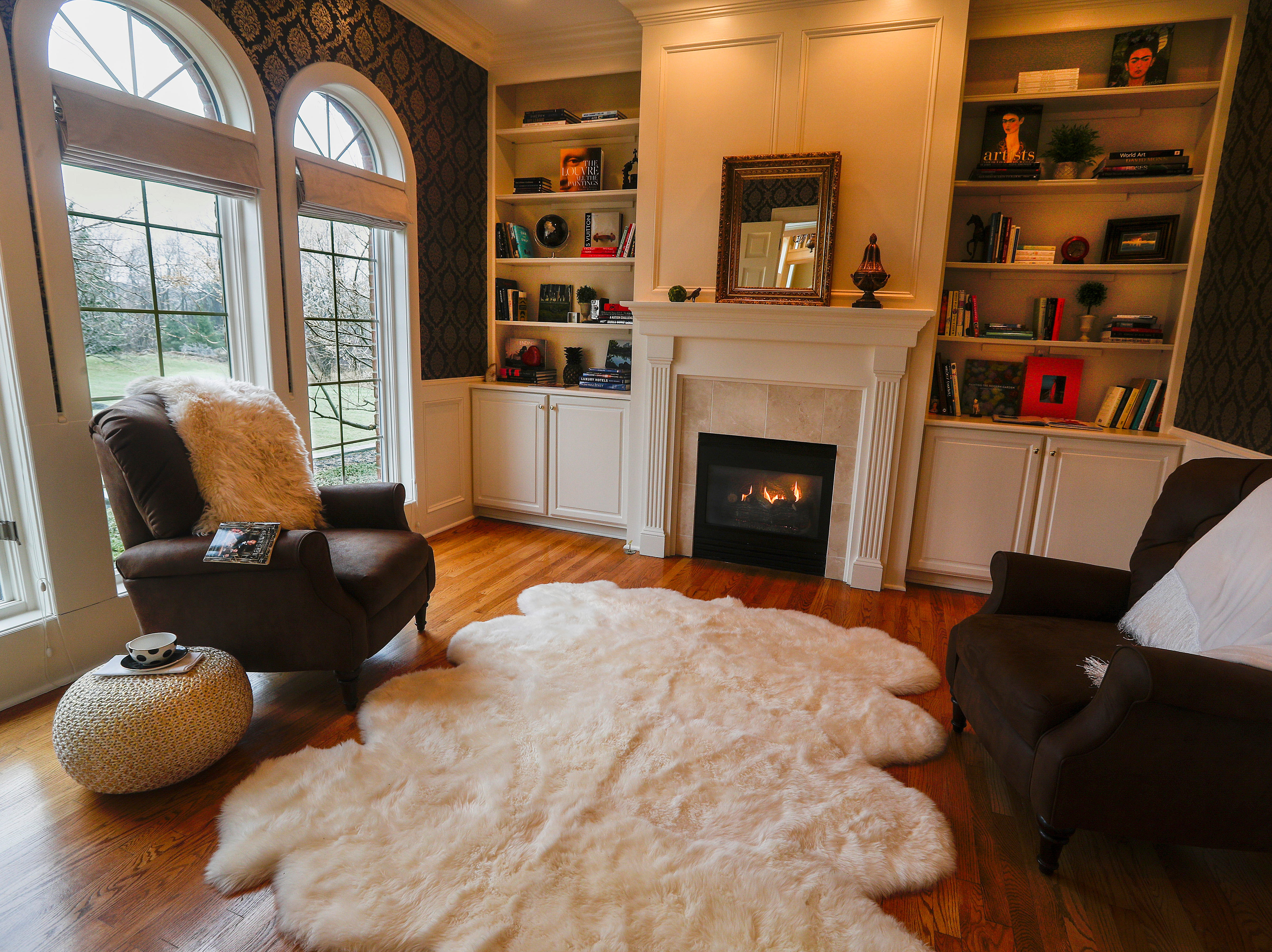A cozy den with fireplace and bookcases.