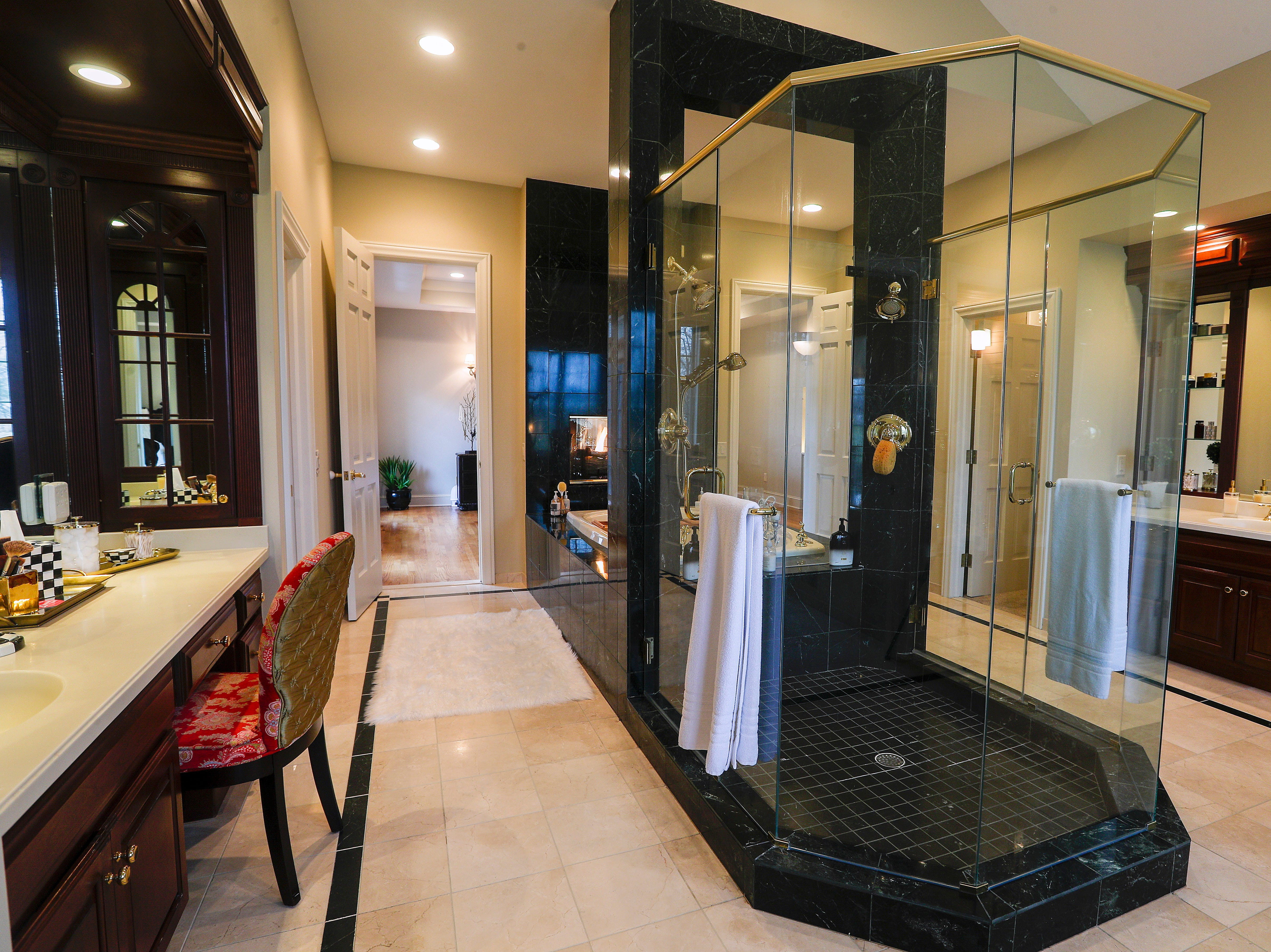 A huge master bathroom includes a large glass shower.