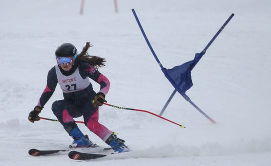 Lucy Haggerty (27) of Victor competes in the girls Alpine Section V Championships at Swain. Victor won the SL single course team race and Haggerty had the best time, 1:14.91.