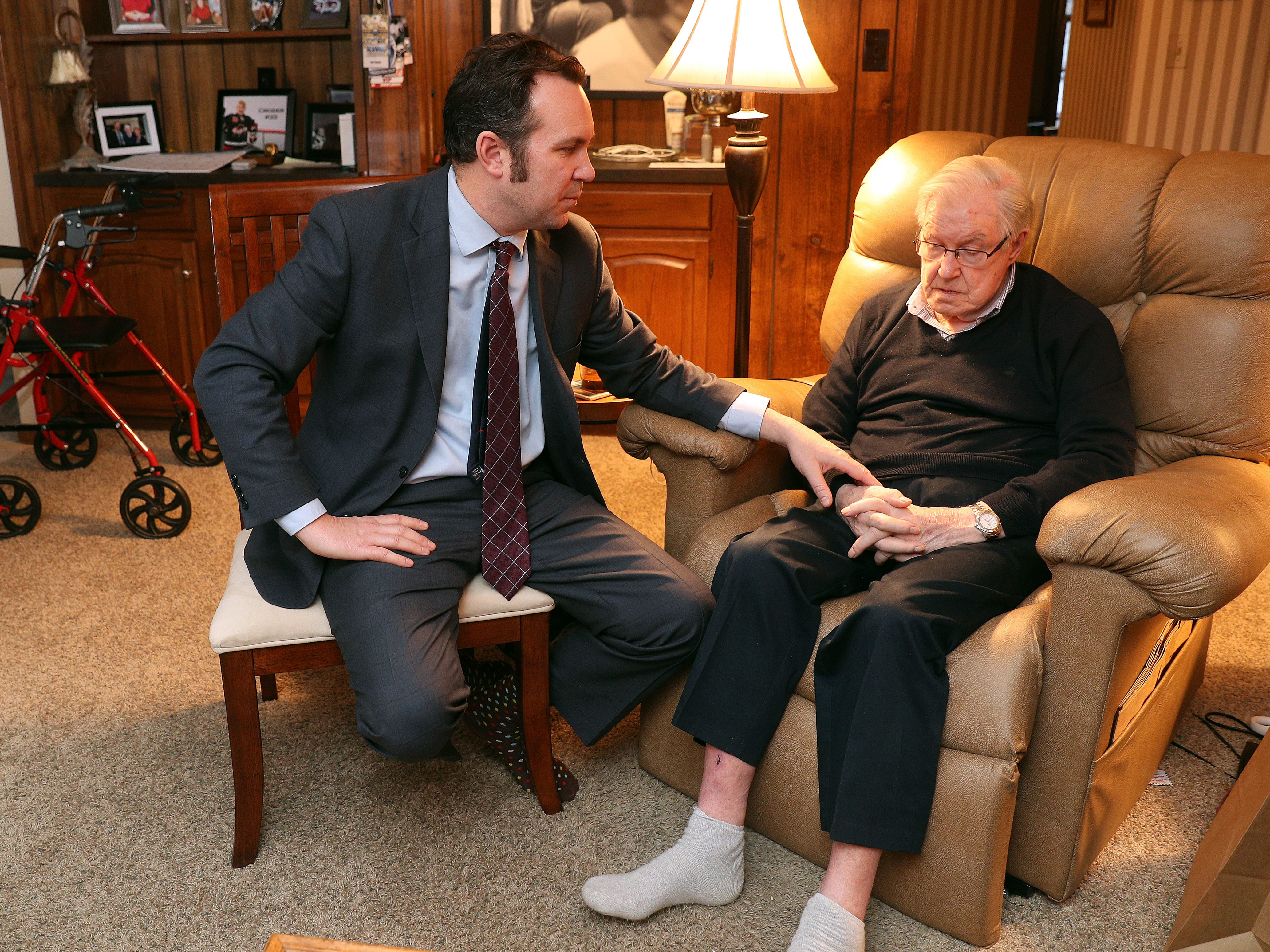 Hockey legend Joe Crozier in his Amherst home with his son, Rich.  Joe Crozier  coached the Rochester Americans to three Calder Cups and later coached the Sabres. He now suffers from accelerating dementia but still loves hockey.