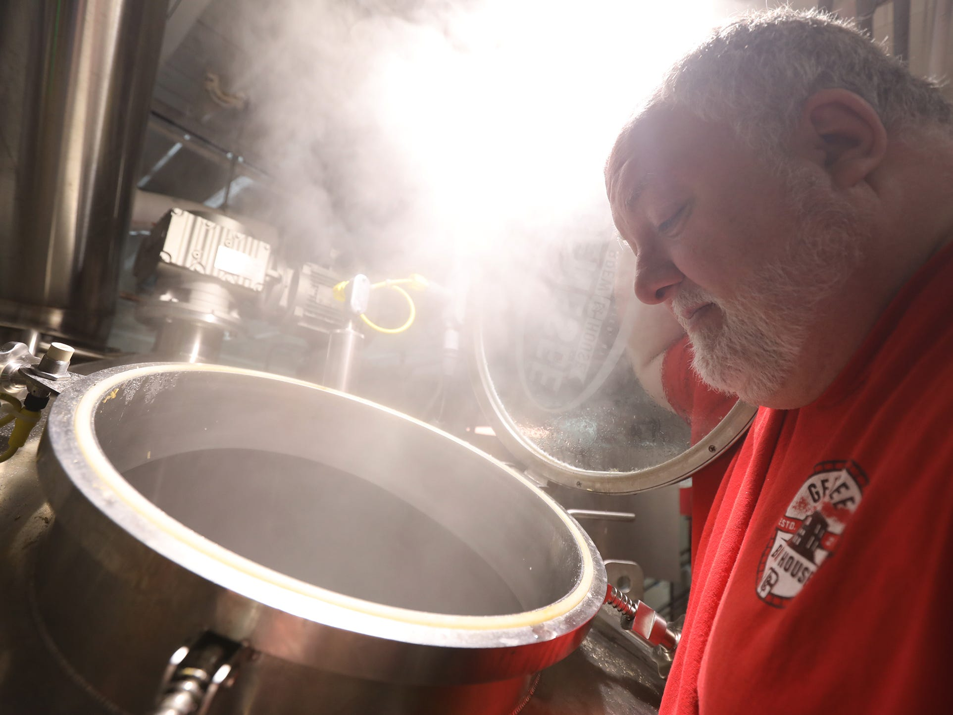 Dean Jones, brewmaster at the Genesee Brew House, checks the progress of the mash during a collaborative brew day with Other Half Brewing on Feb. 12.