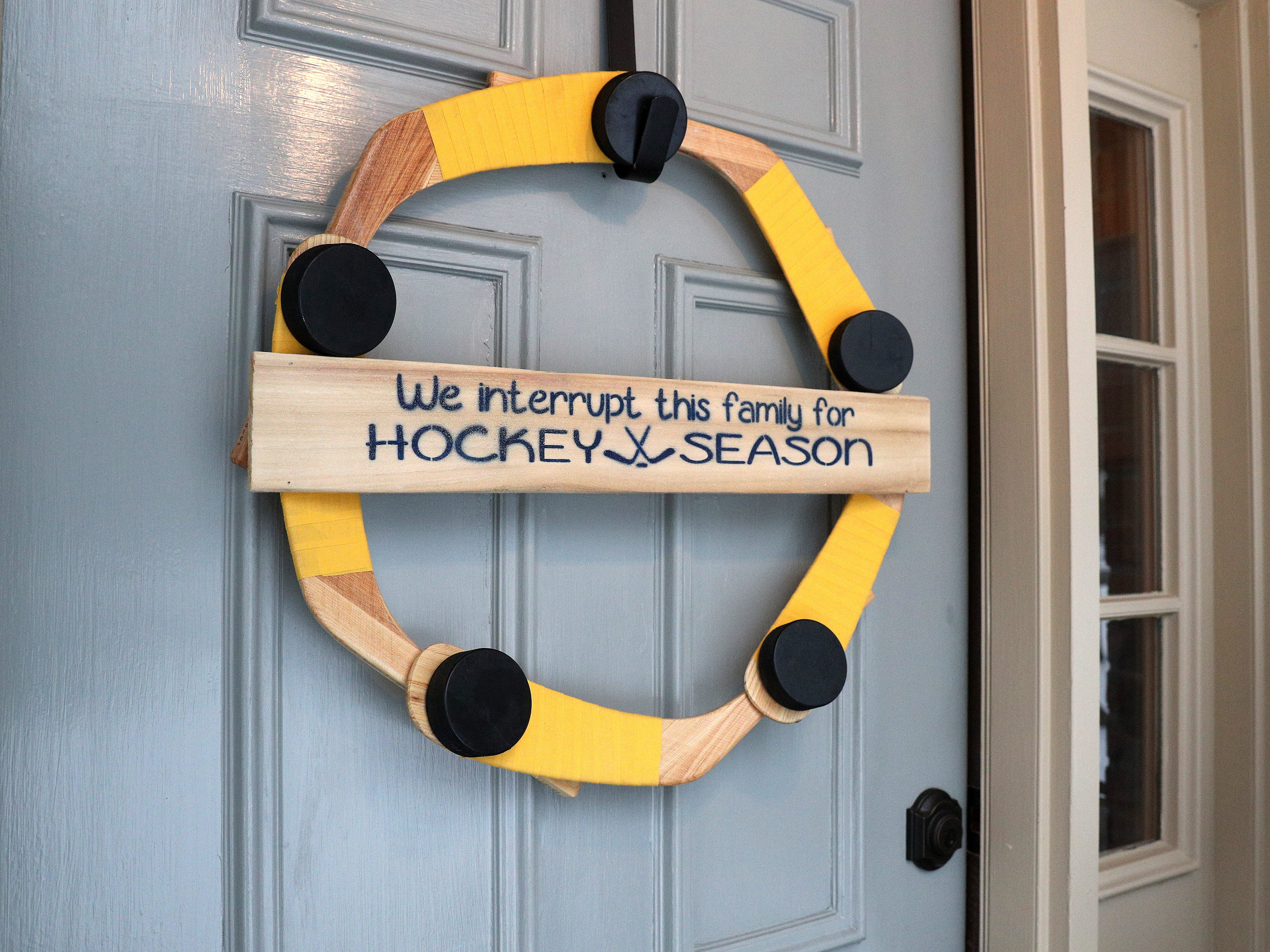 Visitors are welcomed to the Crozier household in Amherst, New York, with a hockey stick wreath on the front door.