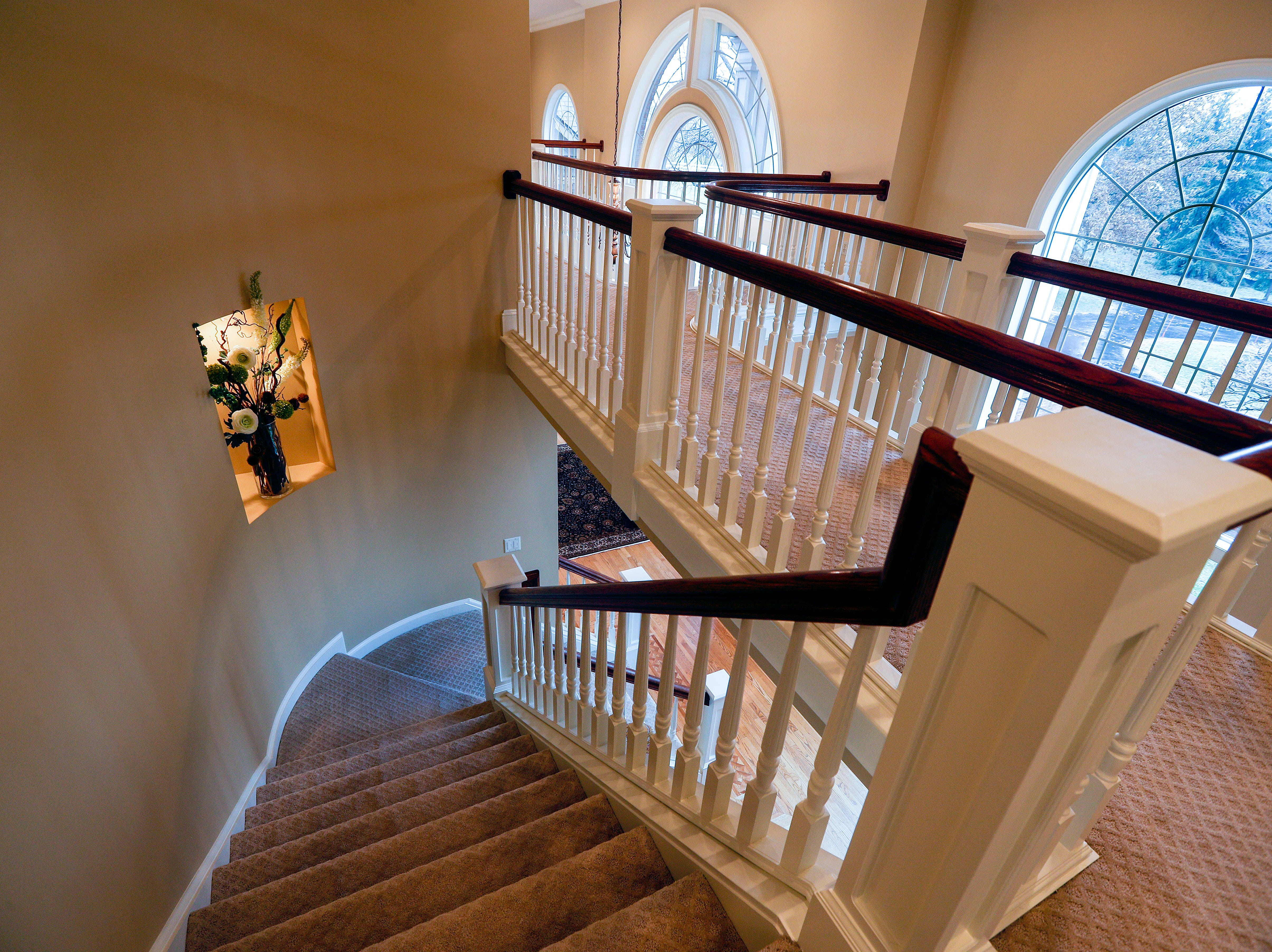 A stairway connects rooms on both sides of the house.