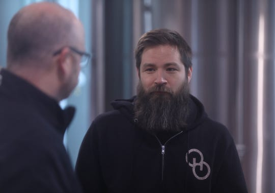 Sam Richardson, Other Half co-owner and brewmaster, chats with Genesee assistant brewmaster Matt James during a collaborative brew day on Feb. 12. Genesee and Other Half teamed to make Genesee Dream Ale. It'll be released in March,