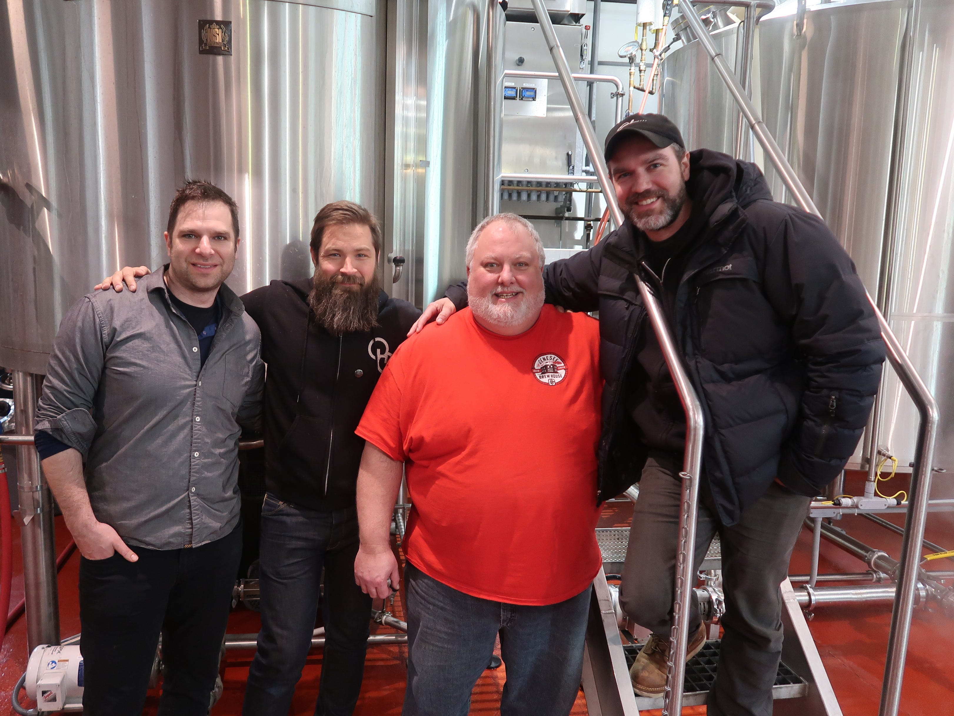 Other Half co-founders Andrew Burman, left, Sam Richardson, second from left, and Matt Monahan, right, with Genesee Brew House brewmaster Dean Jones pose during the collaborative brew day. (Feb. 12, 2019)