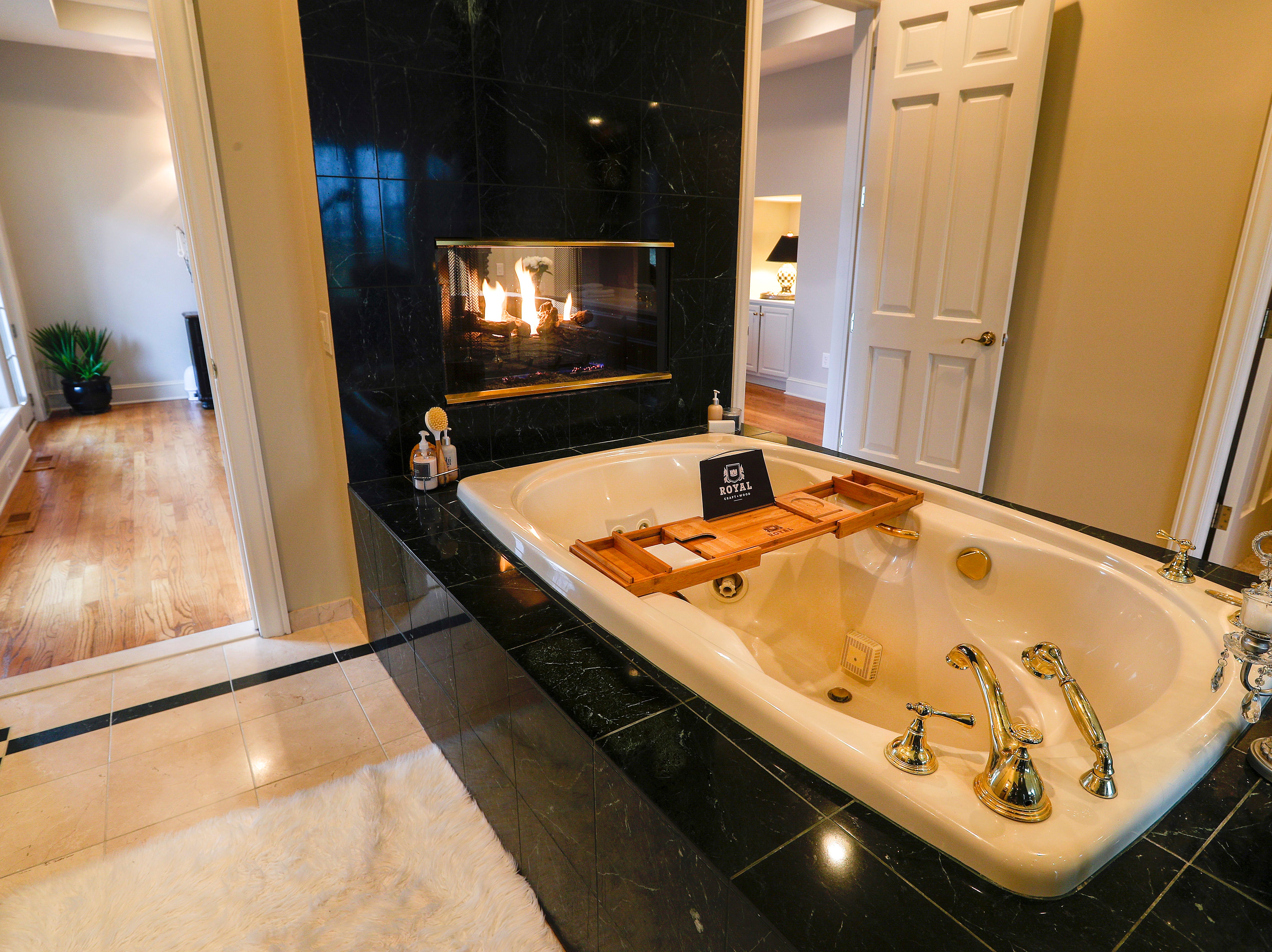 There is a spa tub with  two-way fireplace that shares space in the master bedroom.