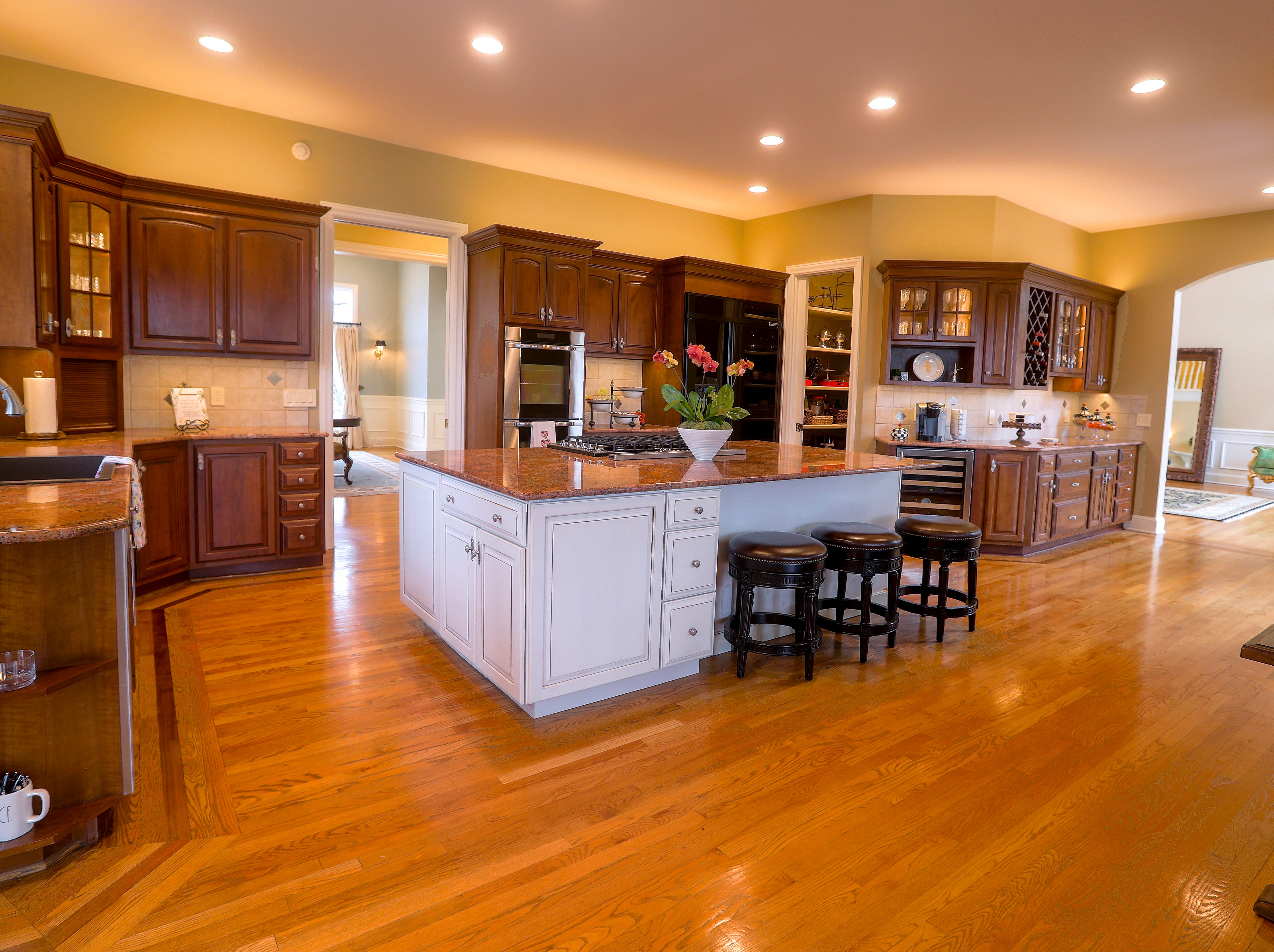 An open kitchen has many views leading into different rooms.