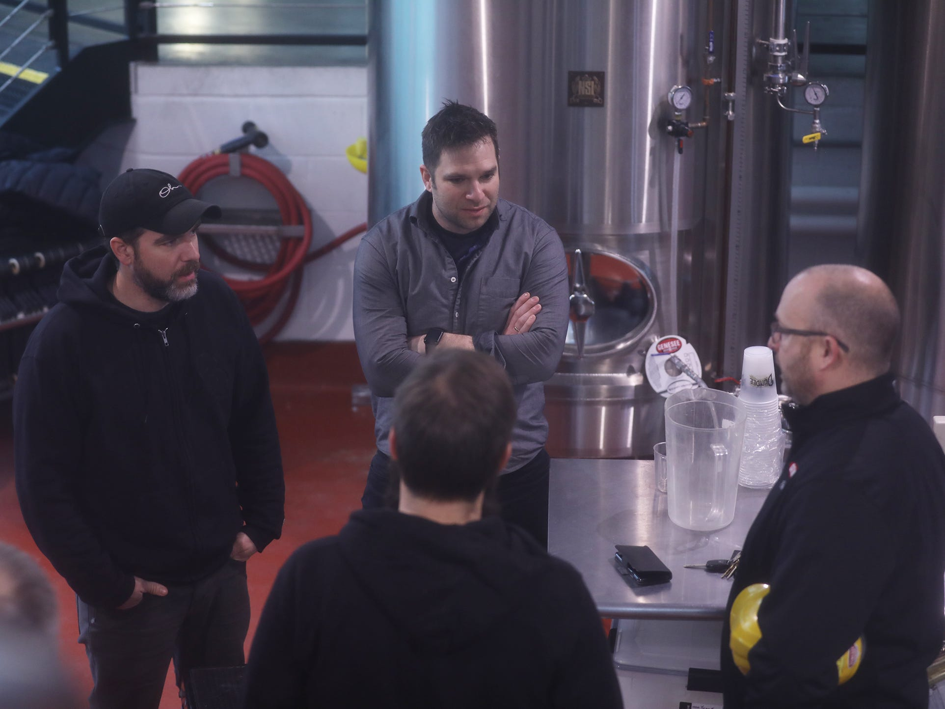 Other Half Brewing folks, Sam Richardson, back to camera and brewmaster, Matt Monahan, CEO, Andrew Burman, COO, talk with Matt James, assistant brewmaster at Genesee Brewery. Genesee is releasing a collaborative beer with Other Half. It's called Genesee Dream Ale.