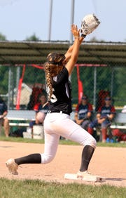 Spencerport softball's Alayna Berry catching a ball with her travel team as part of Black and White baseball/softball in West Henrietta, NY.