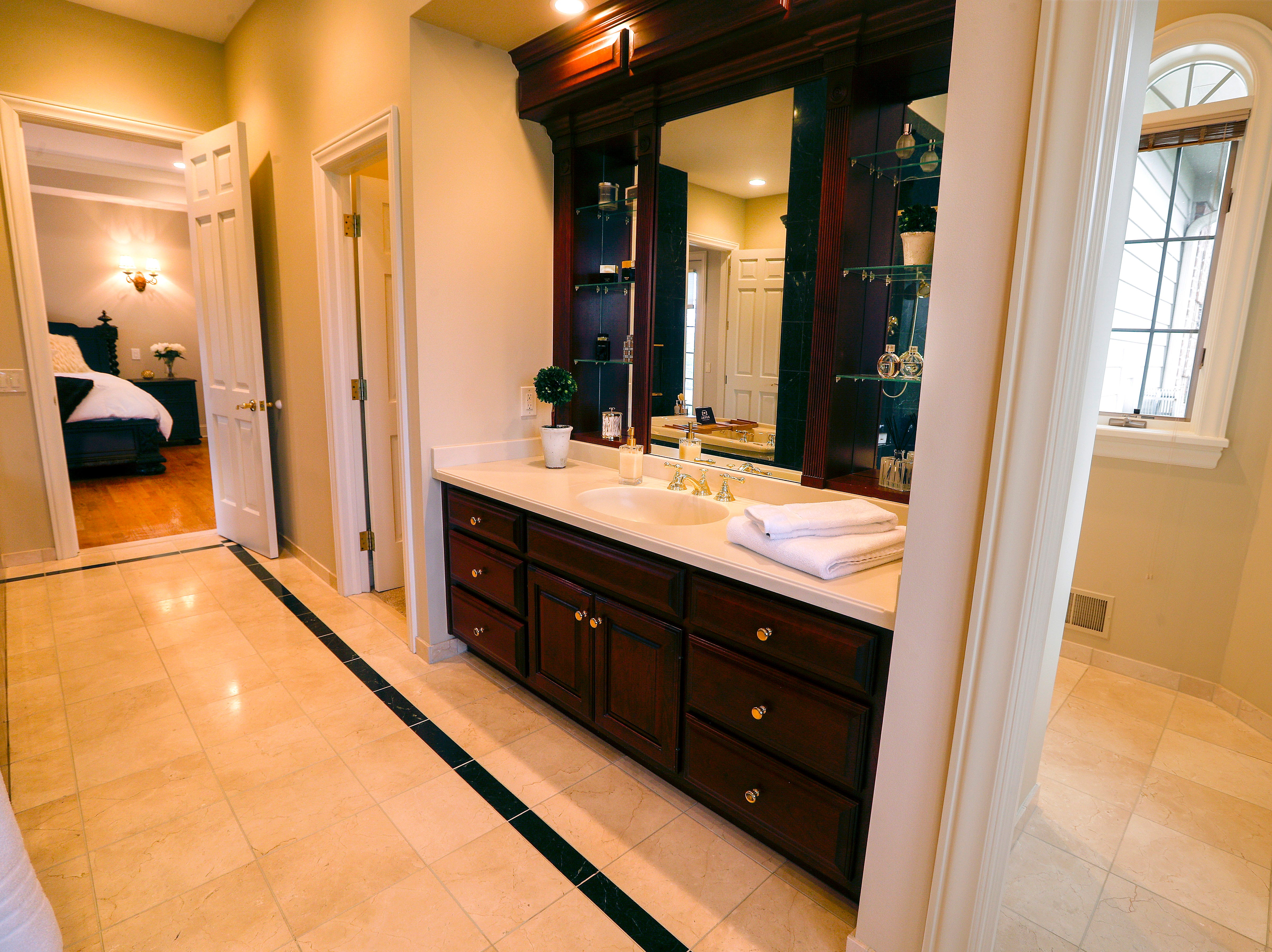 There are two individual areas in the master bathroom.