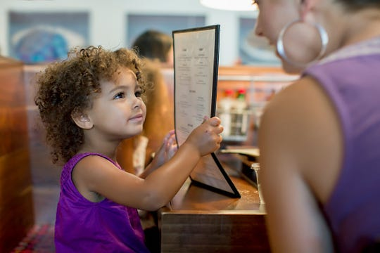Kids-eat-free nights can have a less stressful environment for kids and parents.