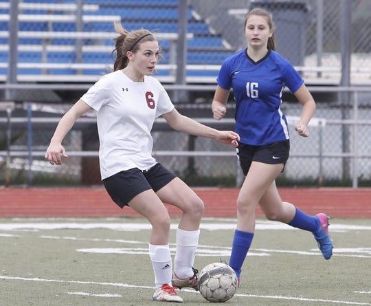 West Valley's Samantha Finnegan looks to pass the ball Thursday, Feb. 7, against U-Prep.