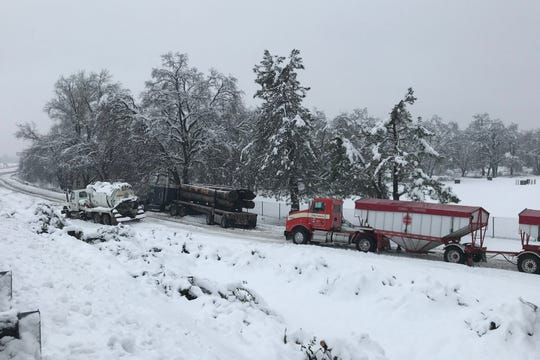 Trucks became stuck in the snow at the onramp to Interstate 5 in Anderson.
