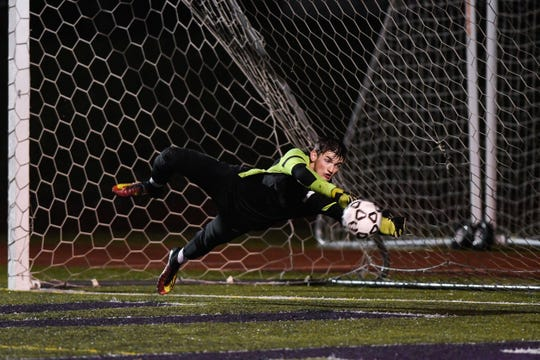 Shasta High goalie Chase Sherman dives to save a shot in a 2-1 loss to Chico on Dec. 15, 2018.